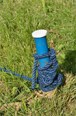 Blue mooring post with rope — Stock Photo