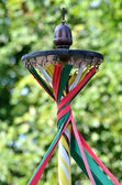 Maypole with twisted ribbons — Stock Photo