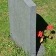 Gravestone with flowers — Stock Photo