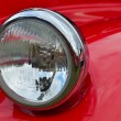 Detail of red headlamp on classic car — Stock Photo