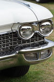 Classic car with radiator and headlights in portrait — Stockfoto