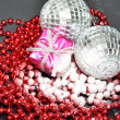 Silver baubles present in snow with beads — Stock Photo