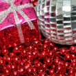 Silver bauble and christmas box on beads — Stock Photo