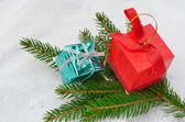 Gift boxes on christmas tree branches — Stock Photo