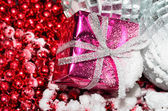 Christmas box over silver and red — Stockfoto