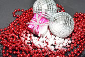 Silver baubles present in snow with beads — 图库照片