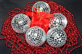 Red box and silver baubles with beads — Stock Photo