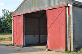 Concrete barn with open doors — Stock Photo