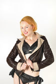 Pretty red head in flying jacket — Stock Photo