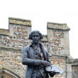 Постер, плакат: Statue of gainsborough with church wall in background