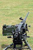 Machine gun on ground — Stock Photo