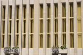 Vertical concrete office block pattern — Stock Photo