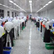 Production line workers — Photo