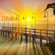 Tropical pier at dusk - Stock Photo