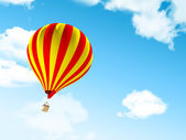 Air balloon in clouds — Stock Photo