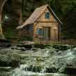 Stock Photo: Little house over waterfalls