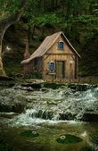 Little house over the waterfalls — Stock Photo