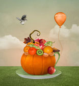 Cup of autumnal fruits — Stock Photo