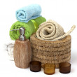 Ceramics Shampoo bottle with towels - Stock Photo