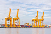 Crane working with container cargo in shipyard — ストック写真