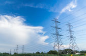 Electricity high voltage power post against blue sky — Stok fotoğraf