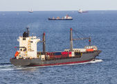 Cargo ship sailing on the sea — Stock Photo