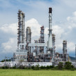 Oil refinery plant against blue sky — Stock Photo #13661988