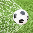 Royalty-Free Stock Photo: Football in the goal net