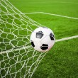 Football in the goal net — Stock Photo #13662339