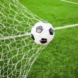 Soccer ball in goal net — Stock Photo #13662560