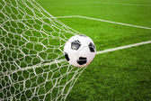Football in the goal net — Stockfoto