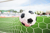 Football in the goal net — Stock Photo