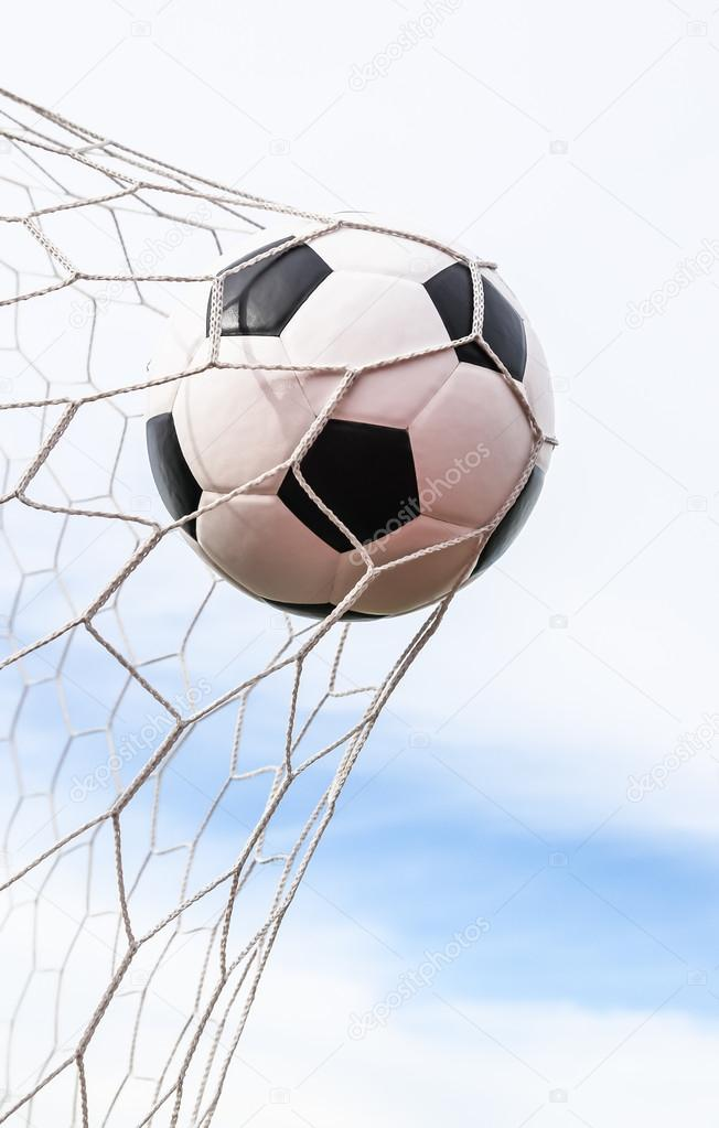 Soccer ball in goal net — Stock Photo #13662562