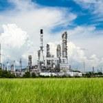 Oil refinery plant against blue sky — Stock Photo #19536145