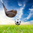 Stock Photo: Driver hit soccer ball on tee