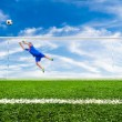 Foot shooting soccer ball out of goal — Stock Photo