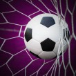 Football in goal net — Stock Photo
