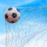 Soccer ball in goal net — Stock Photo #27538833
