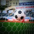 Soccer ball in goal net — Stock Photo