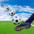Foot kicking soccer ball — Stockfoto