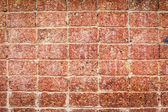 Red stone wall texture for background — Stock Photo