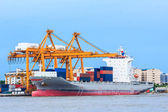 Crane working with container cargo in shipyard — Stock Photo