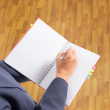 Business man writing on notebook — Stock Photo