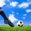 Foot shooting football — Stock Photo