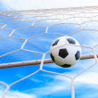 Soccer ball in goal net — Foto de Stock