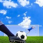 Постер, плакат: Foot shooting soccer ball to goal penalty