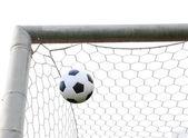Soccer ball in goal net isolated — Stock Photo