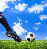 Foot shooting football — Stock Photo