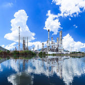 Oil refinery plant along the river with reflection — Stock Photo