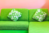 Green sofa in pink room — Stock Photo